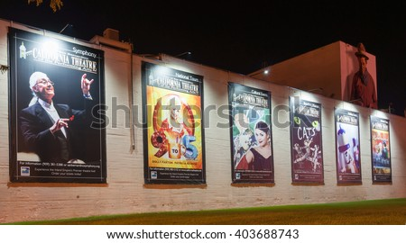 SAN BERNARDINO, USA - OCTOBER 3;Musical show posters on exterior wall of California Theatre of the Performing Arts illuminated at the theater October 3, 2016  San Bernardino, California, USA.