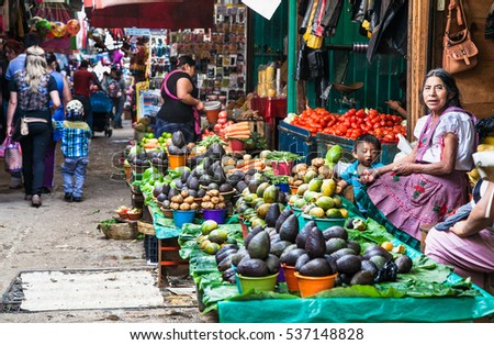 SAN CRISTOBAL, MEXICO-DEC 11, 2015: San Cristobal de las casas inhabited by indigenous Tzotzil Maya people, traditional market, selling fruits and hand crafts on Dec 11, 2015,Chiapas region, Mexico.