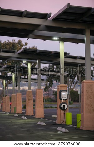 SAN DIEGO, CA - JANUARY 29, 2014: Solar powered electric vehicle car charging station in a public parking lot in California. - stock photo