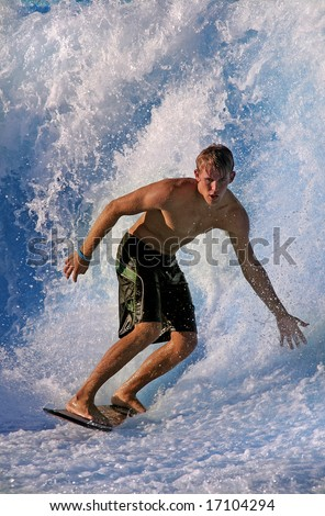 SAN DIEGO, CA - May 12:  Surfer catching wave during  flowriding contest at Wavehouse in San Diego, May 12, 2008. - stock photo