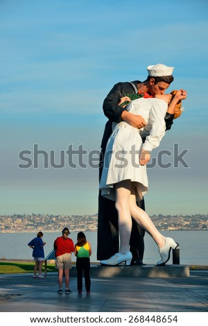 San Diego, CA - MAY 18: Unconditional Surrender sculpture at sea port on May 18, 2014 in San Diego. By Seward Johnson, the statue resembles the photograph of VJ day in Times Square - stock photo