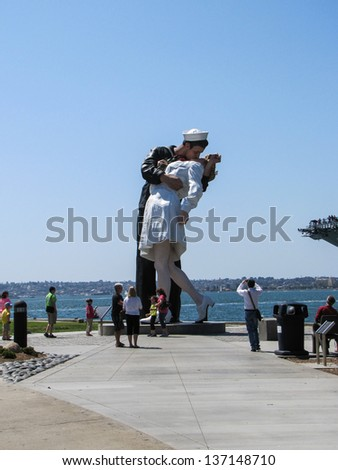 SAN DIEGO,CA,USA-MAY 1: People view The Unconditional Surrender sculpture on May 1,2013.  The sculpture is installed near the Midway Aircraft museum and Bob Hope Park and draws thousands of visitors. - stock photo