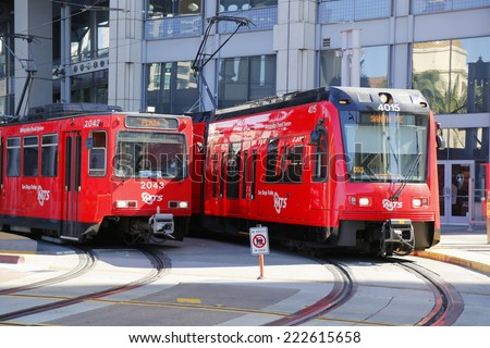 SAN DIEGO, CALIFORNIA - SEPTEMBER 29: City trolley in San Diego on September 29, 2014. The San Diego Trolley  is a light rail system operating in the metropolitan area of San Diego - stock photo