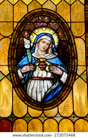SAN DIEGO, CALIFORNIA, USA 07 APRIL: Virgin Mary Sacred Heart  stained Glass in the Immaculate Conception Church on april  07 2015 in Old San Diego CA USA - stock photo