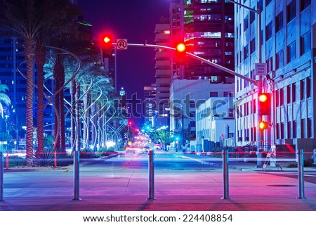 San Diego City Center Intersection at Night. Red Lights Traffic Lights. San Diego, California, USA. - stock photo
