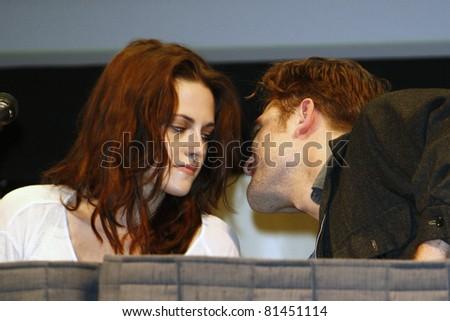 SAN DIEGO - JUL 21: Kristen Stewart; Robert Pattinson at 'The Twilight Saga: Breaking Dawn Part 1' Panel during Comic-Con 2011 in San Diego, California on July 21, 2011 - stock photo