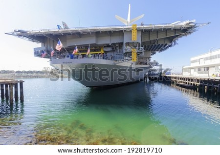 SAN DIEGO,USA - FEBRUARY 24, 2014: The historic aircraft carrier, USS Midway a battleship commissioned after World War II, now a museum, moored in Downtown San Diego, Southern California - stock photo
