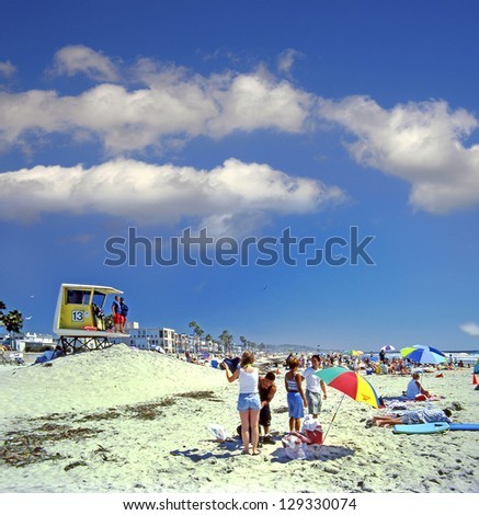SAN DIEGO, USA - JULY 21: Lifeguards and beach in San Diego on July 21, 2001 in California, USA. People spend a hot day in San Diego, mostly on the beach. - stock photo