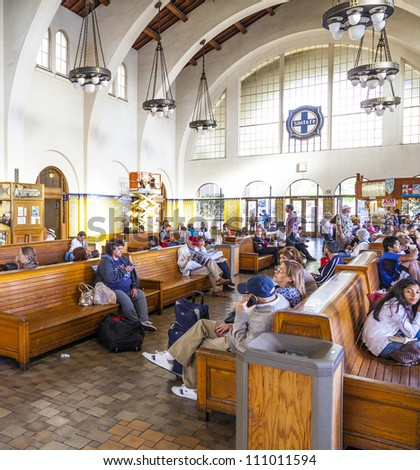 SAN DIEGO, USA - JUNE 11: people wait for the trains inside Union Station on June 11, 2012 in San Diego, USA. The Spanish Colonial Revival style station opened on March 8, 1915 as Santa Fe Depot. - stock photo