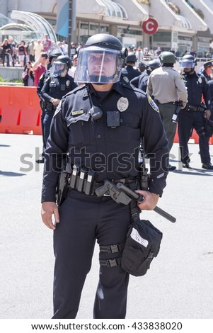 SAN DIEGO, USA - MAY 27, 2016: A San Diego police officer stands ready in riot gear at an anti-Trump demonstration outside a Trump rally at the San Diego Convention Center.
