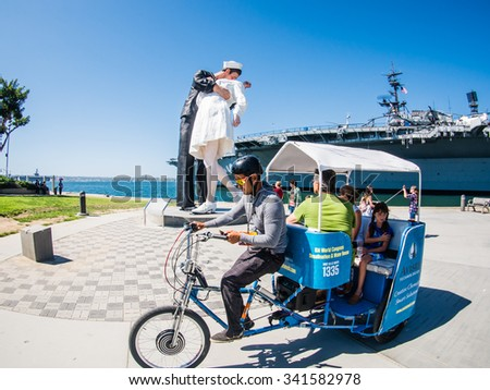 SAN DIEGO, USA - SEPTEMBER 19: Visitors on Unconditional Surrender statue on September 19, 2015 in California, United States. San Diego has estimated population of 1,381,069 as of July 1, 2014. - stock photo