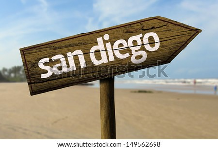 San Diego wooden sign with a beach on background  - stock photo