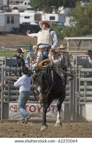 SAN DIMAS, CA - OCTOBER 2: Unidentified cowboy competes in the Saddle Bronc event at the San Dimas Rodeo on October 2, 2010 in San Dimas.