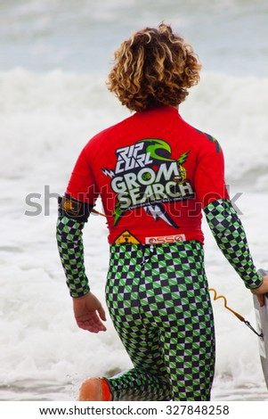 SAN FERNANDO, CADIZ, SPAIN - FEB 19: Unidentified bodyboader going to the water on the 2nd championship of Surf and BodyBoard Impoxibol on Feb 19,2011 on San Fernando, Cadiz, Spain - stock photo