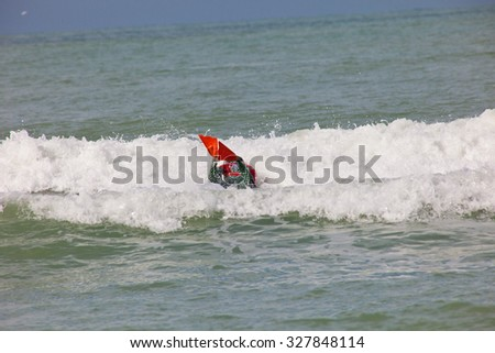 SAN FERNANDO, CADIZ, SPAIN - FEB 19: Unidentified bodyboader taking waves on the 2nd championship of Surf and BodyBoard Impoxibol on Feb 19,2011 on the beach of Camposoto of San Fernando, Cadiz, Spain - stock photo
