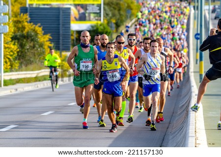 SAN FERNANDO, SPAIN - MAR 23: Unidentified runners on the street during XXVIII Half Marathon Bahia de Cadiz on March 23 , 2014, in San Fernando , Spain - stock photo