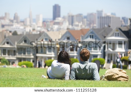 San Francisco - Alamo Square people. Couple in Alamo Park by the Painted Ladies, The Seven Sisters, San Francisco, California, USA. - stock photo