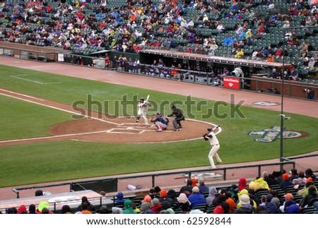 SAN FRANCISCO - APRIL 11: Braves Vs. Giants: Pablo Sandoval lifts leg during at bat waiting for incoming pitch, catcher Brian McCann waiting for ball.  April 11 2010 Att Park San Francisco California - stock photo