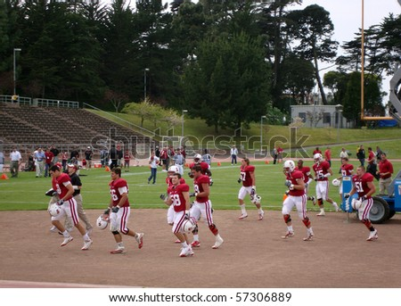SAN FRANCISCO-APRIL 17: Stanford players run off the field at halftime during the 2010 Practice game . Taken April 17 2010 at historic Kezar Stadium in San Francisco California - stock photo