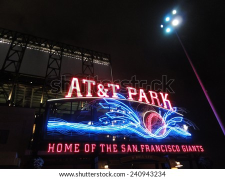 SAN FRANCISCO - AUGUST 27: AT&T Park - Home of the Giants - Neon Sign at night with visual of baseball splashing into the water taken on August 27 2011 at Att Park in San Francisco California. - stock photo