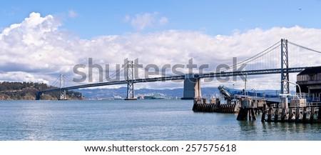 San Francisco Bay Bridge and Clouds Panoramic - stock photo