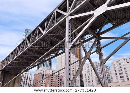 San Francisco Bay Bridge Structure, Downtown Buildings - stock photo