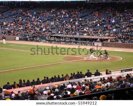 SAN FRANCISCO, CA - APRIL 1: Giants vs. A's: Edgar Renteria swings for contact during a exhibition night baseball game, taken at At&T Park San Francisco on April 1, 2010. - stock photo