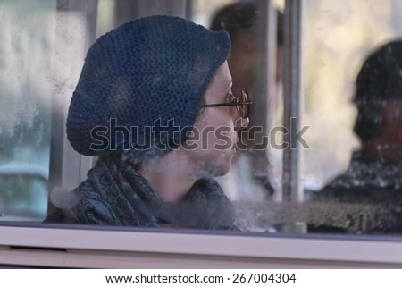 SAN FRANCISCO, CA - April 4,2015 - Woman riding public transportation bus in San Francisco. - stock photo