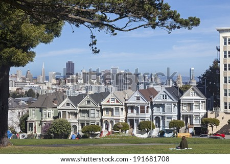 SAN FRANCISCO, CA - FEB. 28, 2013: Victorian Houses Painted Ladies in San Francisco, California. Painted Ladies are the Famous Icon at the Bay Area near Alamo Square Park.
