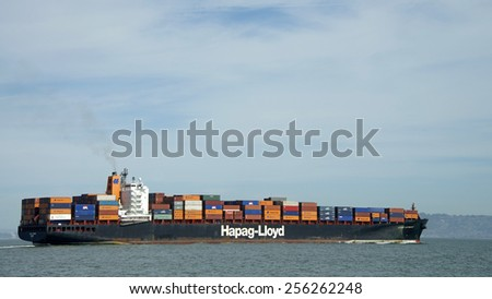 SAN FRANCISCO, CA - FEBRUARY 26, 2015: Hapag-Lloyd Cargo Ship KOBE EXPRESS in the San Francisco Bay en route to the Port of Oakland, the fifth busiest container port in the United States.