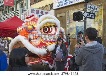 SAN FRANCISCO, CA - FEBRUARY 20, 2016: Unidentified Participants pose for photos with Dragon Head at Chinese New Years Festival. San Francisco's China Town is the oldest Chinatown in the US.