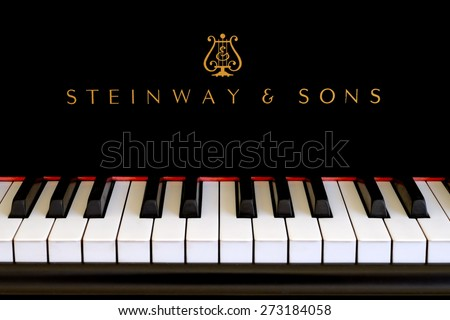 SAN FRANCISCO, CA-JAN 4, 2015: Steinway & Sons logo close up. Classic gold lettering above the piano keys of a ebony black Steinway grand piano.  - stock photo