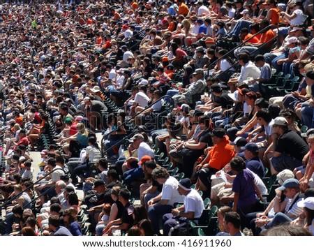 SAN FRANCISCO, CA - JULY 3: Rows of San Francisco Giants fans watch baseball from seats taken July 3, 2011 AT&T Park San Francisco California.  - stock photo