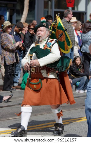 SAN FRANCISCO, CA - MARCH 12: A man dressed in Irish kilt plays uilleann pipes - a traditional Irish musical instrument during the St. Patric's Day Parade March 12, 2011 in San Francisco, CA