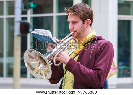 SAN FRANCISCO, CA - MARCH 17: A man playing saxhorn during the St. Patric's Day Parade. March 17, 2012 in San Francisco, CA - stock photo
