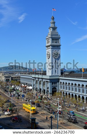 SAN FRANCISCO, CA - MARCH 28, 2015: Local people and tourists mingle as they shop among the vendors' tents and farmers' market surrounding the ferry building. - stock photo