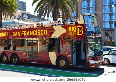 SAN FRANCISCO, CA - MARCH 29, 2015: Passengers riding on the top tier of a double-decker tour bus are treated to a magnificent view of the city. - stock photo
