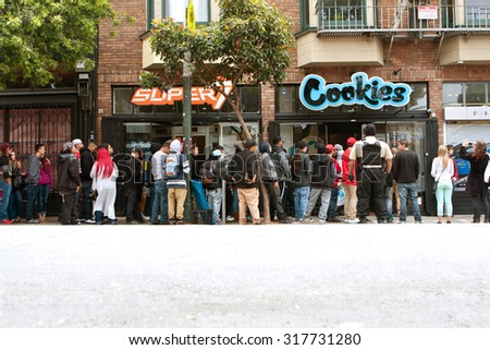SAN FRANCISCO, CA - MAY 15:  A long line of people waits to get into a new Cookies store on May 15, 2015 in San Francisco.  Cookies sells clothes and marijuana-related swag and accessories.  - stock photo