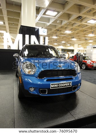 SAN FRANCISCO, CA - NOVEMBER 20: Front side of Blue Mini Cooper S on Display at the 53rd International Auto Show November 20 2010 San Francisco. - stock photo