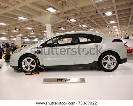 SAN FRANCISCO, CA - NOVEMBER 20: Plug-in Hybrid car the Chevy Volt on display on a spinning platform is displayed at the 53rd International Auto Show, on Saturday November 20, 2010 San Francisco CA. - stock photo
