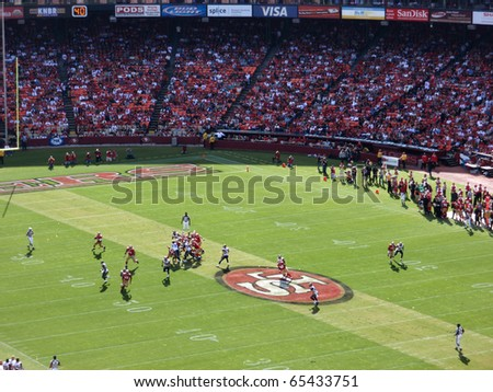SAN FRANCISCO, CA - NOVEMBER 14: Rams vs. 49ers: 49ers Quarterback Troy Smith sets to throw football to receiver at Candlestick Stadium San Francisco California Sunday November 14 2010. - stock photo