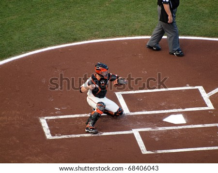 SAN FRANCISCO, CA - OCT. 20: Buster Posey sets to throw back to the pitcher during warm up game 4 2010 NLCS game between Giants & Phillies on Oct. 20, 2010 at AT&T Park in San Francisco, CA. - stock photo