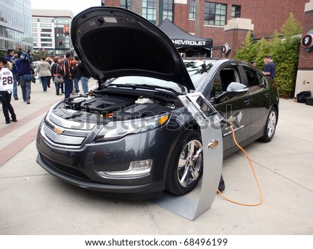 SAN FRANCISCO, CA - OCTOBER 27: Chevy Volt on display at ballpark with hood open before game 1 2010 World Series game Giants and Rangers Oct. 27, 2010 AT&T Park San Francisco, CA. - stock photo