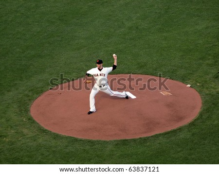 SAN FRANCISCO, CA - OCTOBER 20: Giants vs. Phillies: Madison Bumgarner steps forward to throws pitch from mound during game four of the NLCS 2010 October 20, 2010 AT&T Park San Francisco. - stock photo