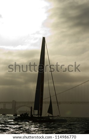 SAN FRANCISCO, CA - OCTOBER 4: Italy's Luna Rossa Swordfish sails near the Golden Gate Bridge in the America'??s Cup World Series sailing races in San Francisco, CA on October 4, 2012 - stock photo