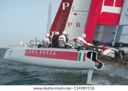 SAN FRANCISCO, CA - OCTOBER 4: Italy'??s Team Luna Rossa competes in the America'??s Cup World Series sailing races in San Francisco, CA on October 4, 2012 - stock photo