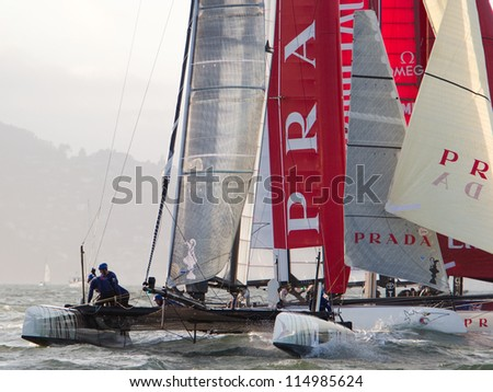SAN FRANCISCO, CA - OCTOBER 4: Luna Rossa Swordfish and Team China compete in the America's Cup World Series sailing races in San Francisco, CA on October 4, 2012 - stock photo