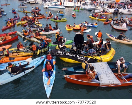 SAN FRANCISCO, CA - OCTOBER 27: McCovey Cove filled with kayaks, boats and people during game 1 of the 2010 World Series game between Giants and Rangers Oct. 27, 2010 AT&T Park San Francisco, CA. - stock photo