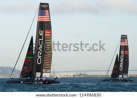 SAN FRANCISCO, CA - OCTOBER 4: Oracle Team USA boats skippered by James Spithill and Russell Coutts compete in the America's Cup World Series sailing races in San Francisco, CA on October 4, 2012 - stock photo
