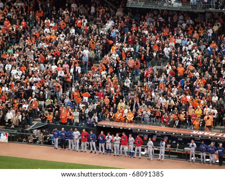SAN FRANCISCO, CA - OCTOBER 28: Players stand with hats removed in front of the dugout during national anthem game 2 2010 World Series Giants and Rangers Oct. 28, 2010 AT&T Park San Francisco. - stock photo